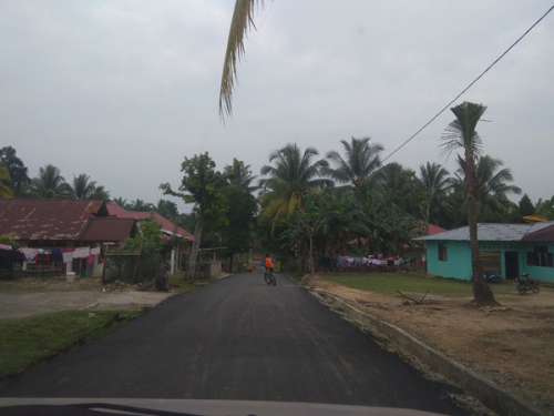 Pemkab Kampar Aspal Jalan di Desa Tanjung, Kades Ucapkan Terimakasih dan Berharap Tahun Depan Ditambah