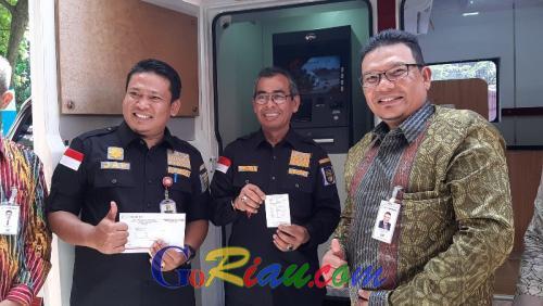 Bupati Mursini Sudah Rasakan Mudahnya Bayar PBB P2 Melalui ATM Bank Riaukepri