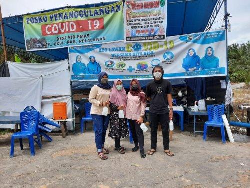 Tim Kukerta Unri Berpartisipasi dalam Pencegahan Covid-19 di Desa Air Emas